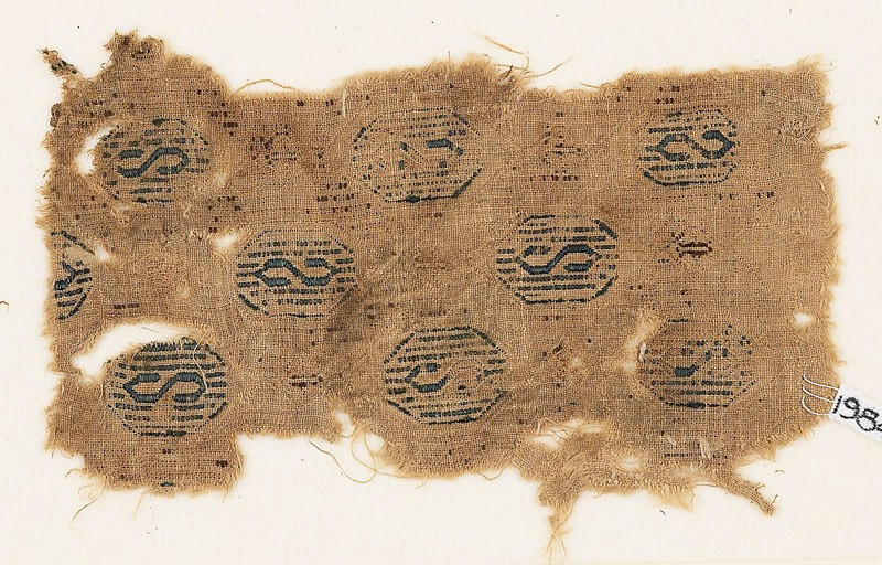 Textile fragment with hexagons containing an S-shape (EA1984.461, front            )