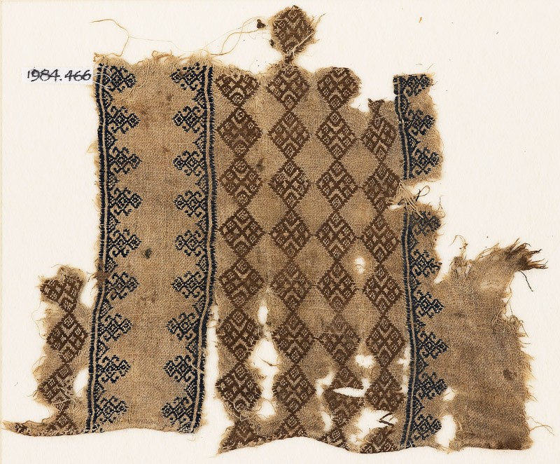 Textile fragment with linked squares (front            )