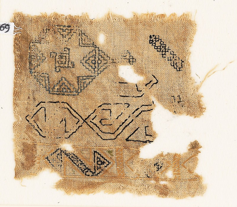 Sampler fragment with an eight-pointed star
