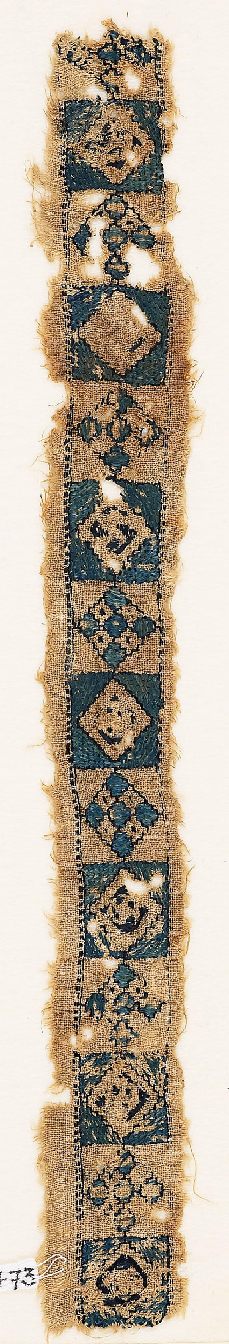 Textile fragment with alternating diamond-shapes and quatrefoils