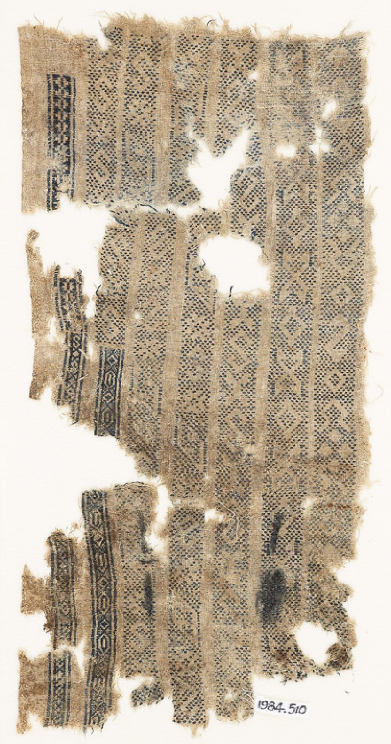 Textile fragment with seven parallel bands