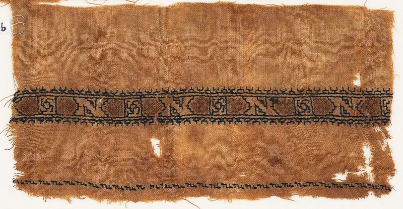 Textile fragment with band of Z-shapes and squares
