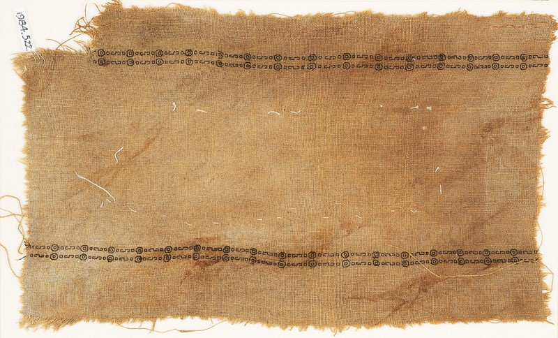 Textile fragment with two parallel bands of circles and S-shapes (front            )