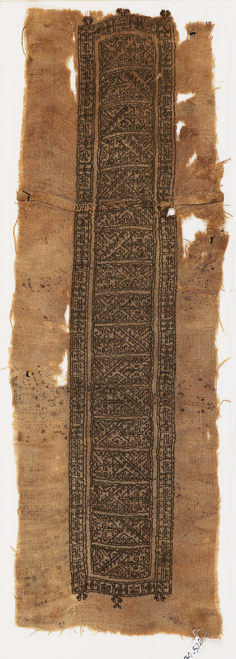 Textile fragment with hooks, lions, and crosses, possibly from a tunic (front            )