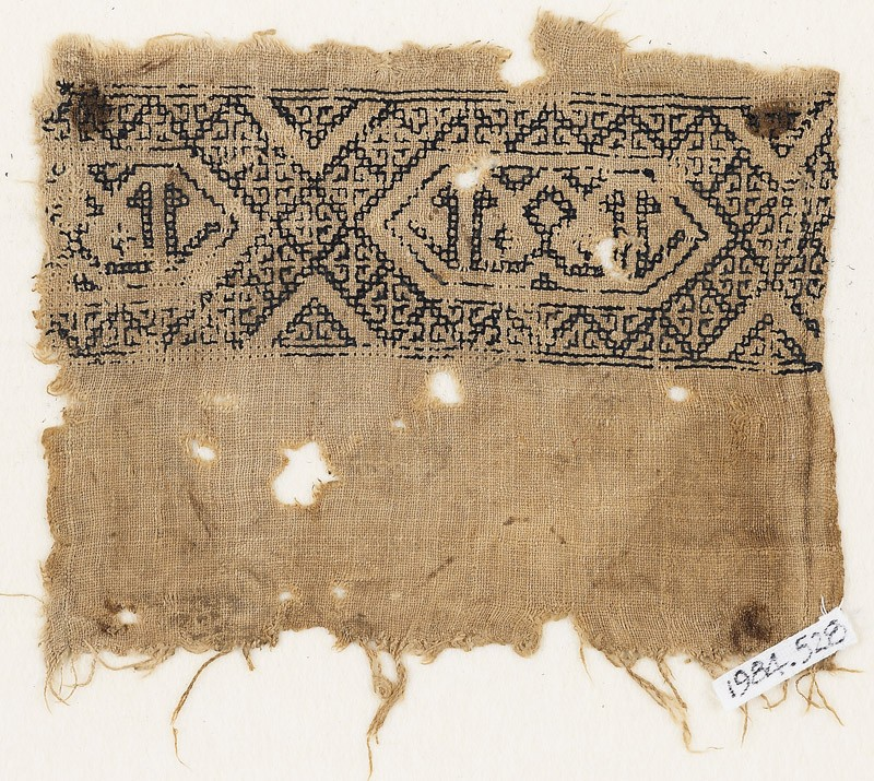 Textile fragment with band of linked hexagons (EA1984.528, front            )