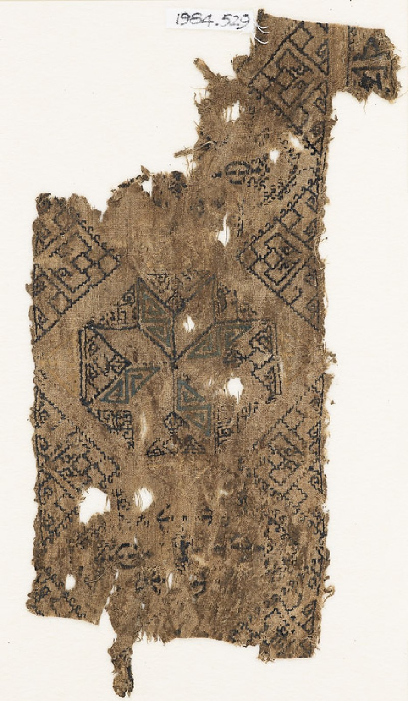 Textile fragment with octagon containing an eight-pointed star (front            )