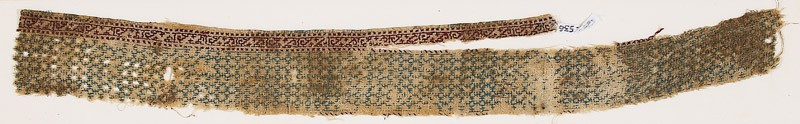 Textile fragment with linked diamond-shapes and possibly pseudo-inscription (EA1984.536, front            )