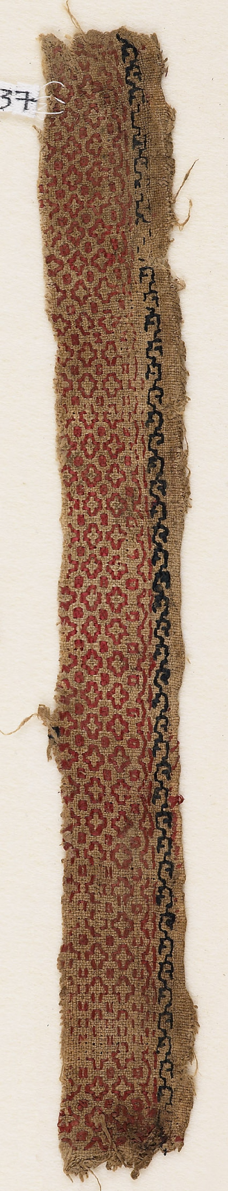 Textile fragment with cross-shaped diamonds and dots