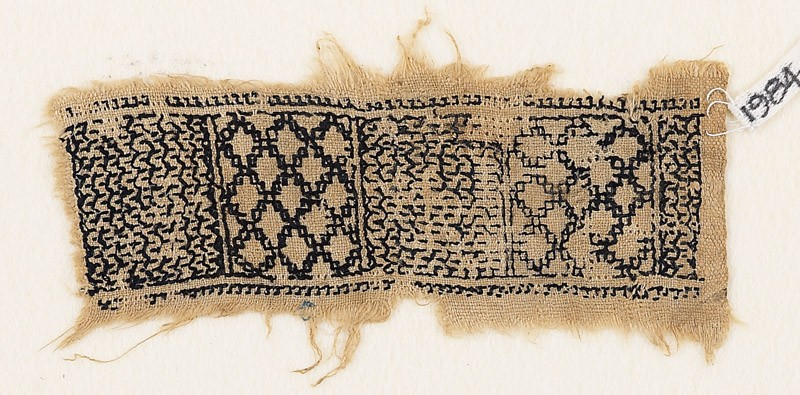 Textile fragment with chevrons and diamond-shapes