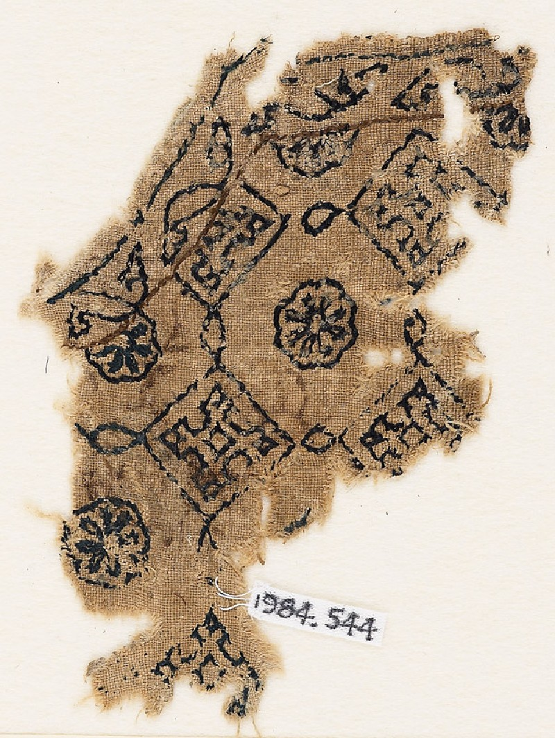 Textile fragment with squares linked by ovals, probably from the neck of a garment