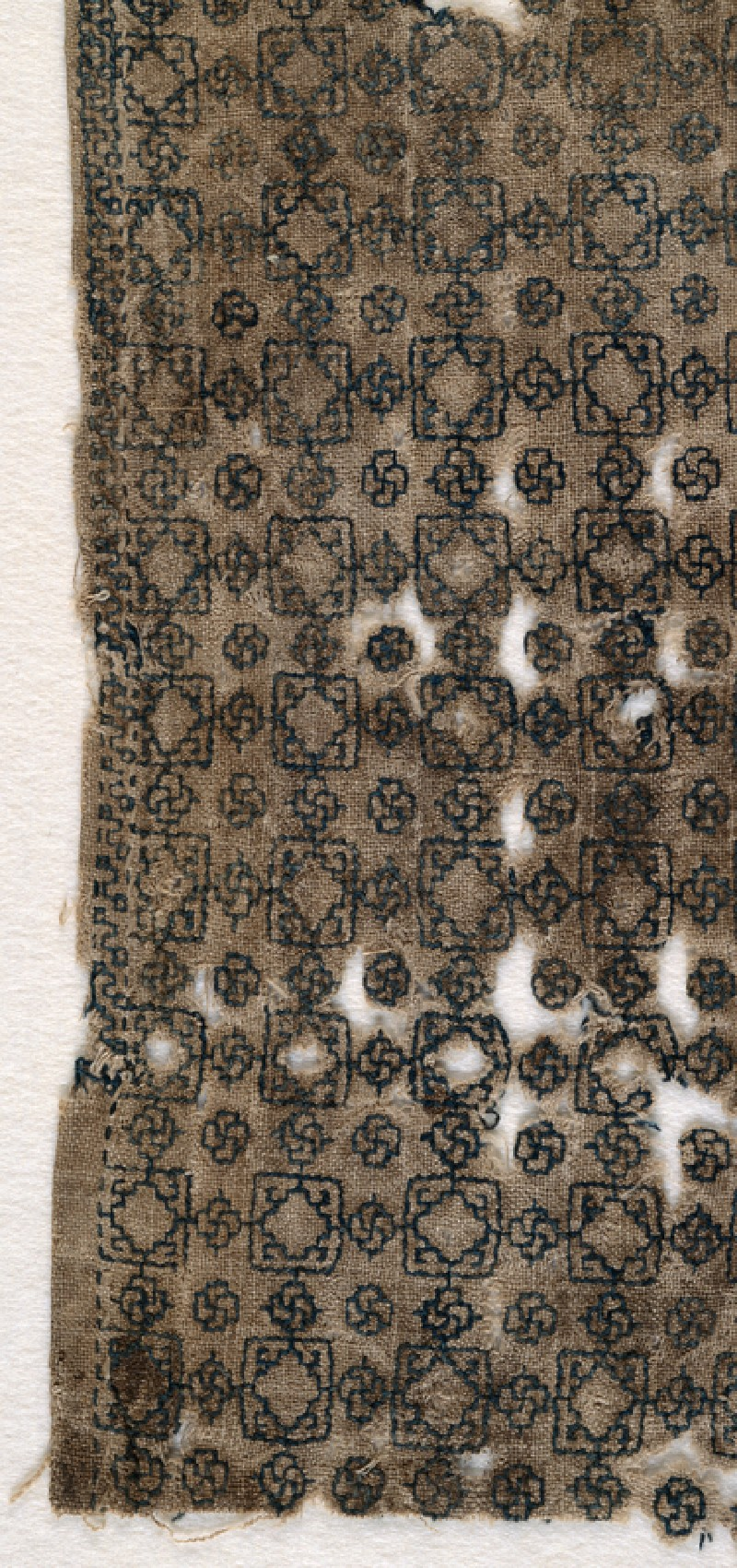 Textile fragment with squares and interlacing knots (front            )