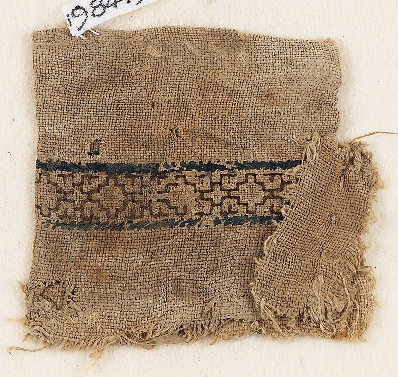 Textile fragment with stepped diamond-shapes, possibly from a money pouch (EA1984.549, front            )