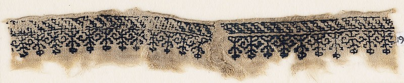 Textile fragment with row of flowers