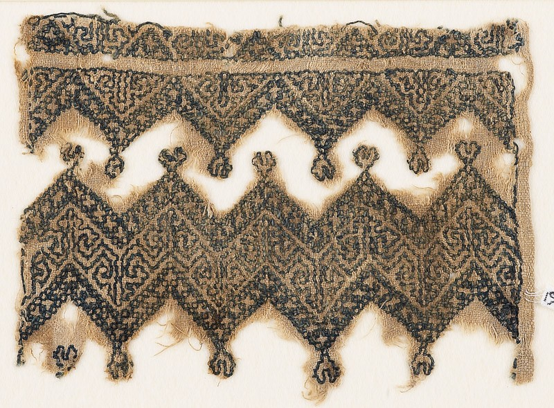 Textile fragment with chevrons and linked trefoils