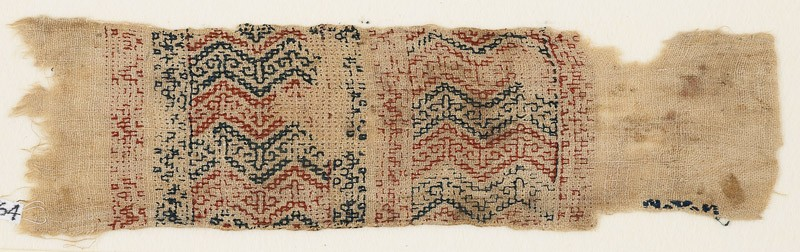 Textile fragment with two parallel bands filled with chevrons