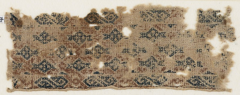 Textile fragment with diamond-shapes set into a diagonal grid (EA1984.567, front            )