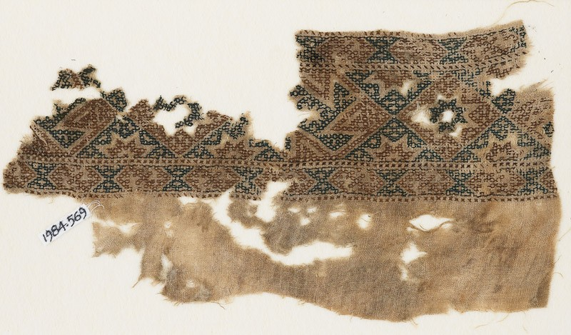 Textile fragment with alternating diamond-shapes and hexagons