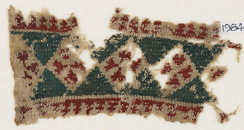 Textile fragment with diamond-shapes containing Maltese crosses