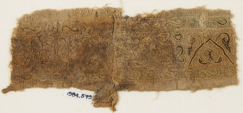 Textile fragment with lotuses, and interlacing vine and leaves