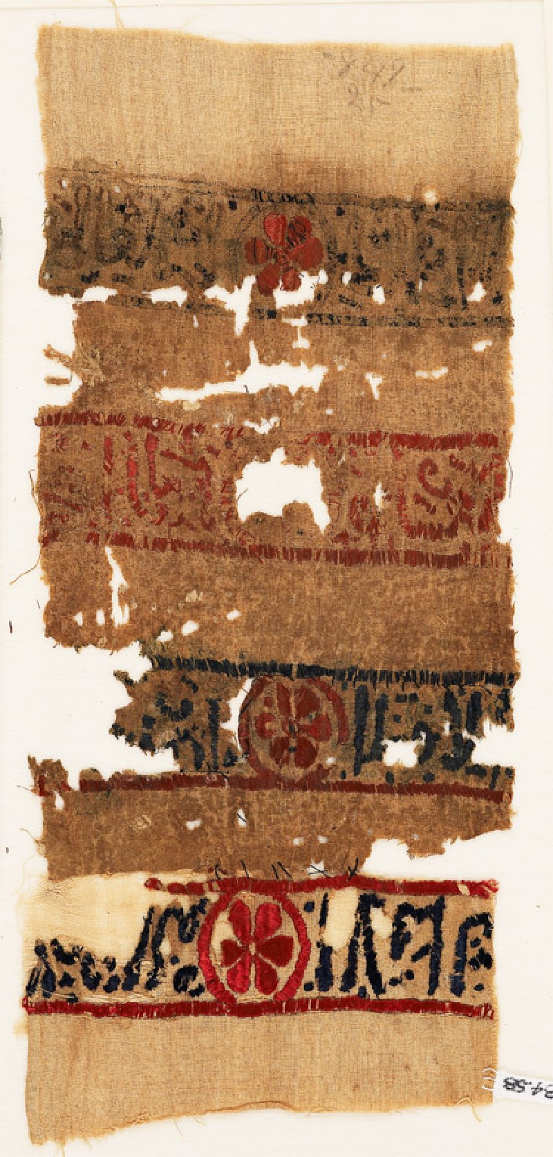 Textile fragment with bands of inscription and blazons