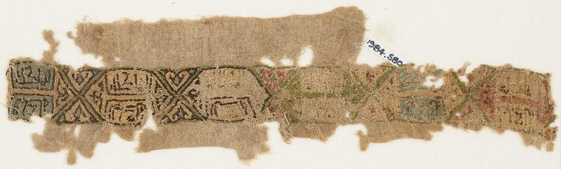 Textile fragment with band of linked cartouches