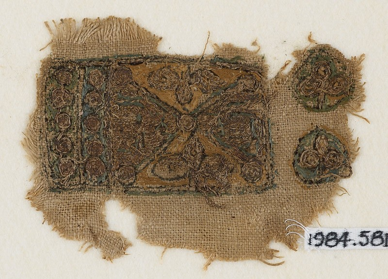 Textile fragment with two trefoils and rows of circles