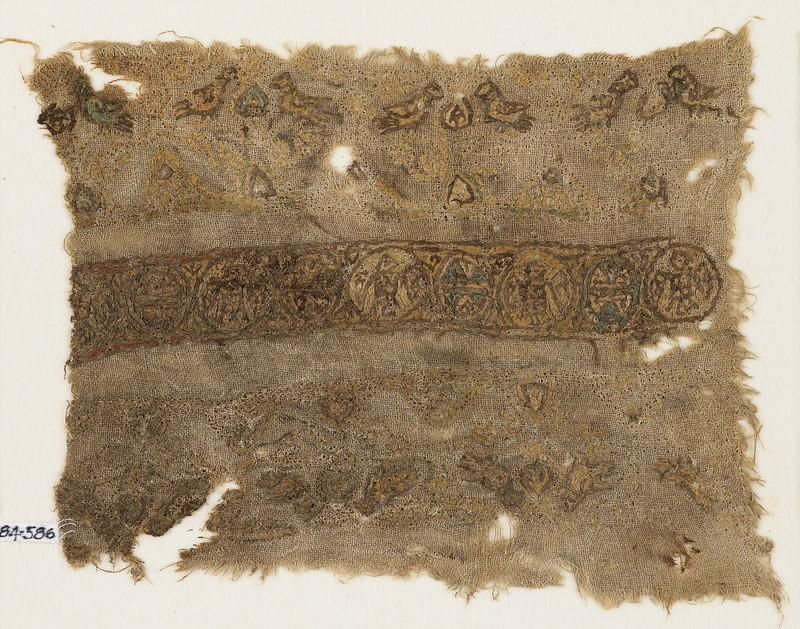 Textile fragment with linked circles and paired birds