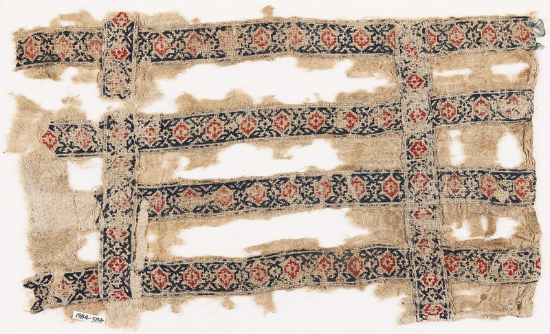 Textile fragment with six bands containing linked circles