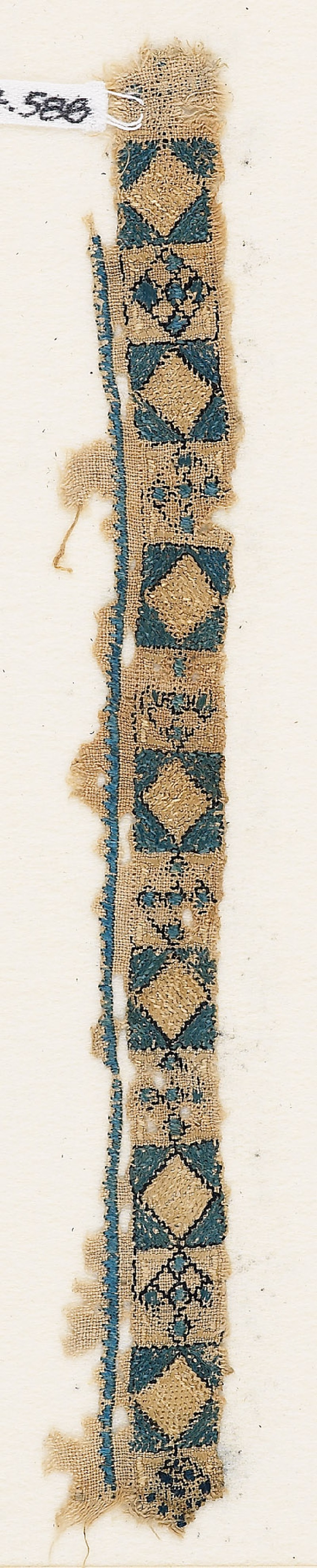 Textile fragment with band of diamond-shapes and crosses (EA1984.588, front            )