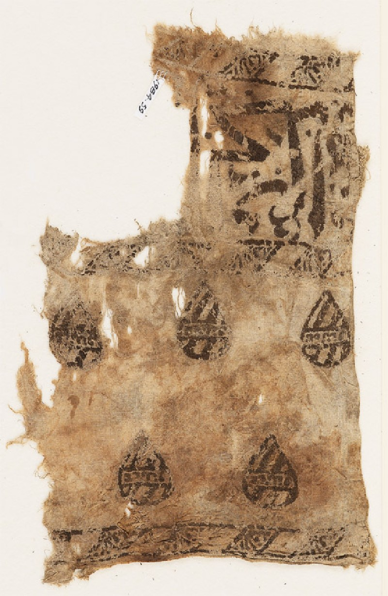 Textile fragment with blazons and remains of naskhi inscription