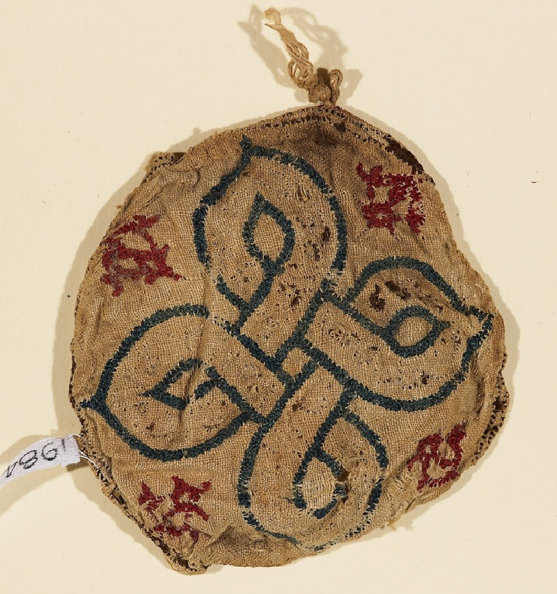 Textile fragment with interlacing knot (EA1984.595, top            )
