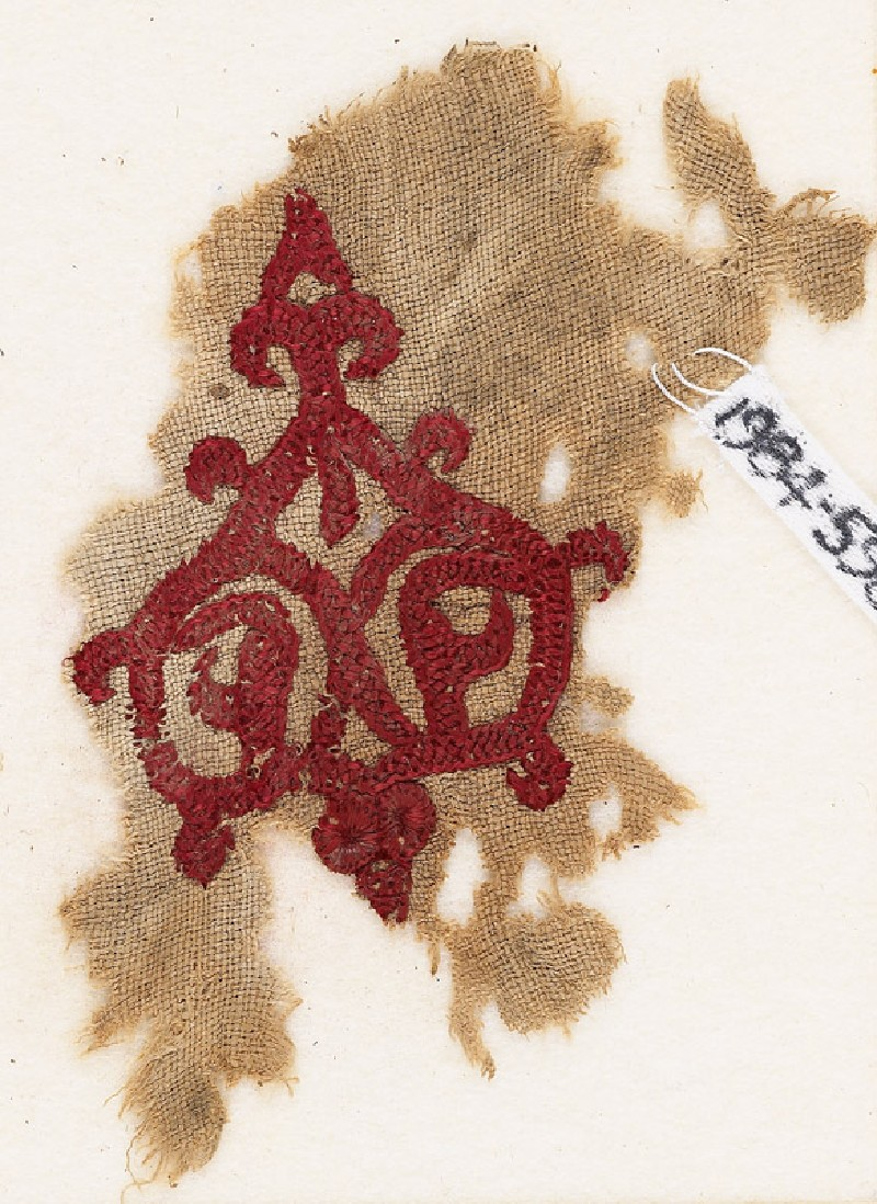 Textile fragment with tendrils and trefoil peak
