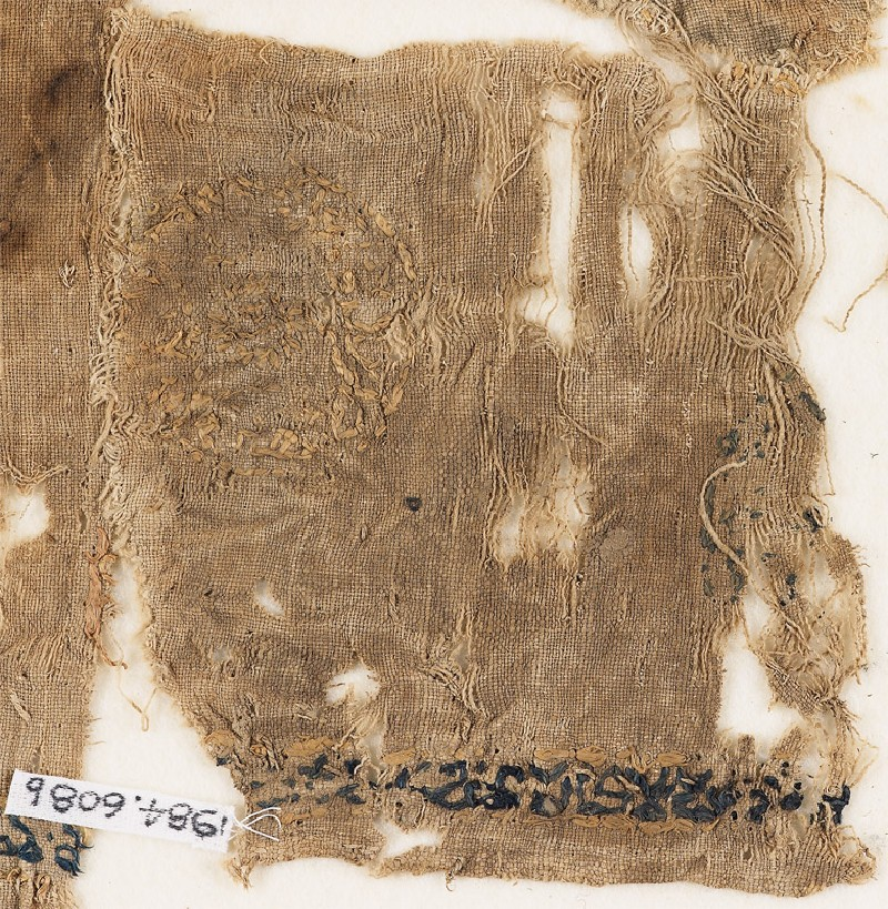 Textile fragment with circles containing lozenges