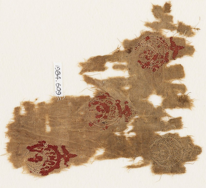 Textile fragment with three circles containing crescents