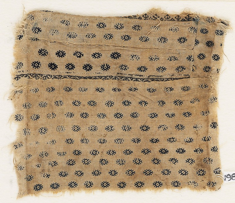 Textile fragment with flowers or diamond-shapes, possibly from a garment (EA1984.612, front            )