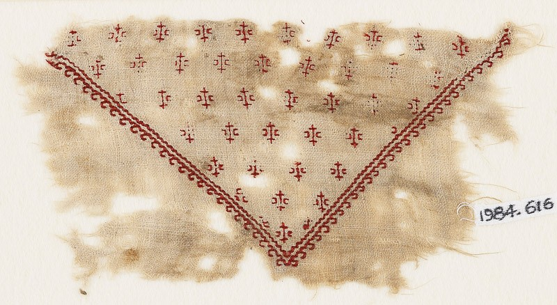 Textile fragment with row of hooks