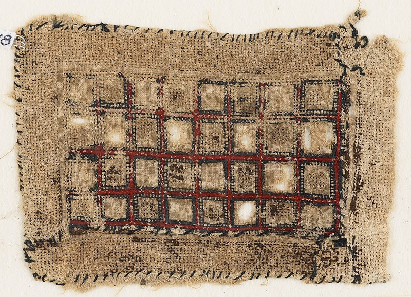 Textile fragment with rectangle containing squares