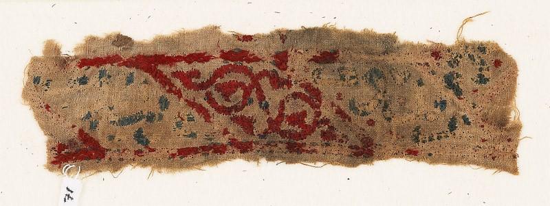 Textile fragment with lozenges, arabesque, and inscription