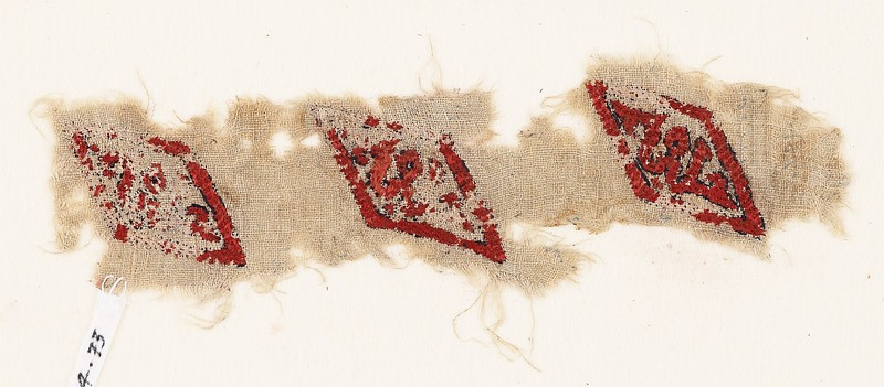 Textile fragment with lozenges and inscription