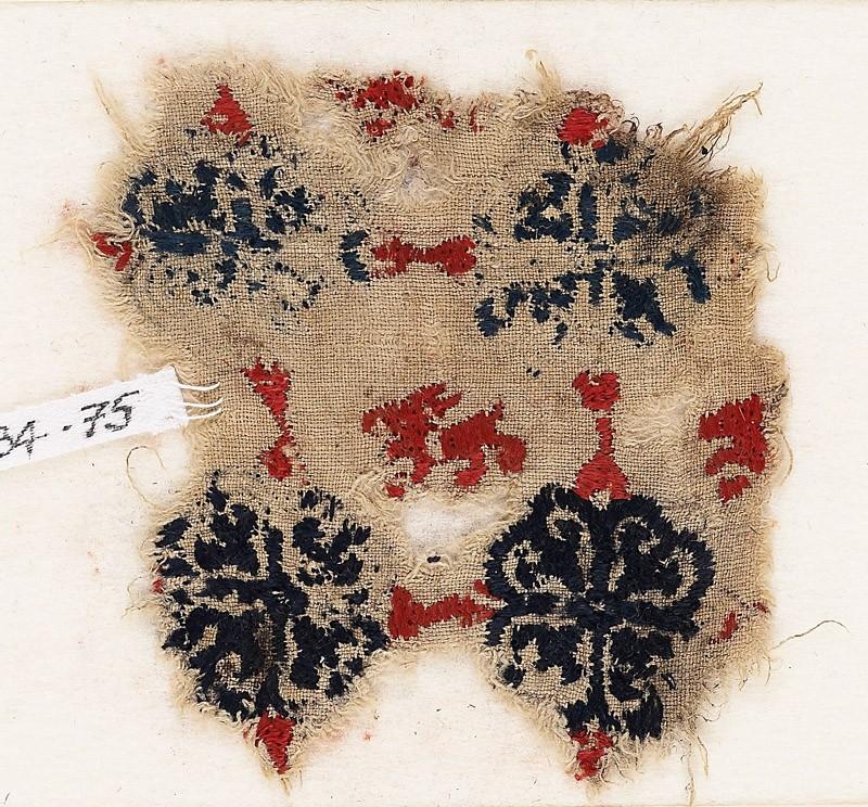 Textile fragment with lion and grid of quatrefoil flowers