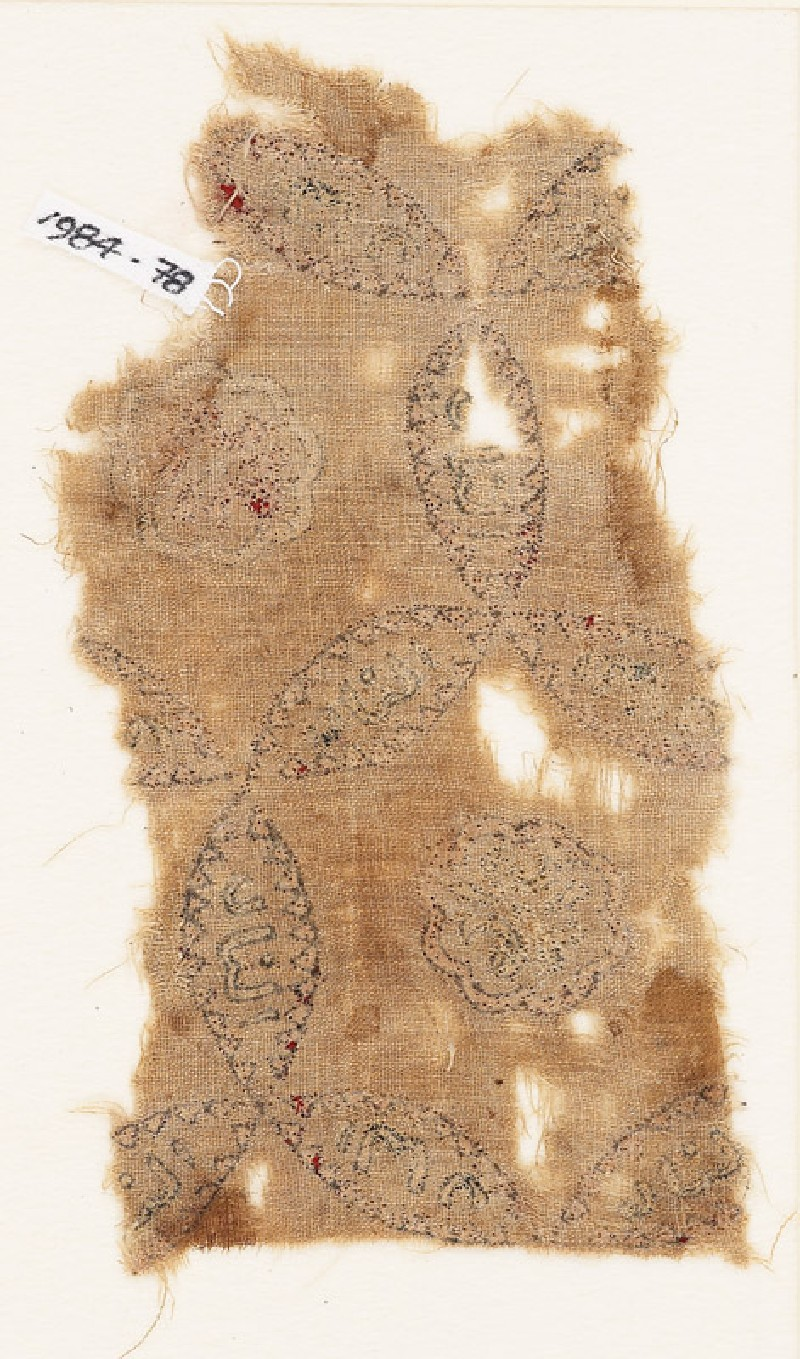 Textile fragment with linked circles, inscription, and possibly a lion
