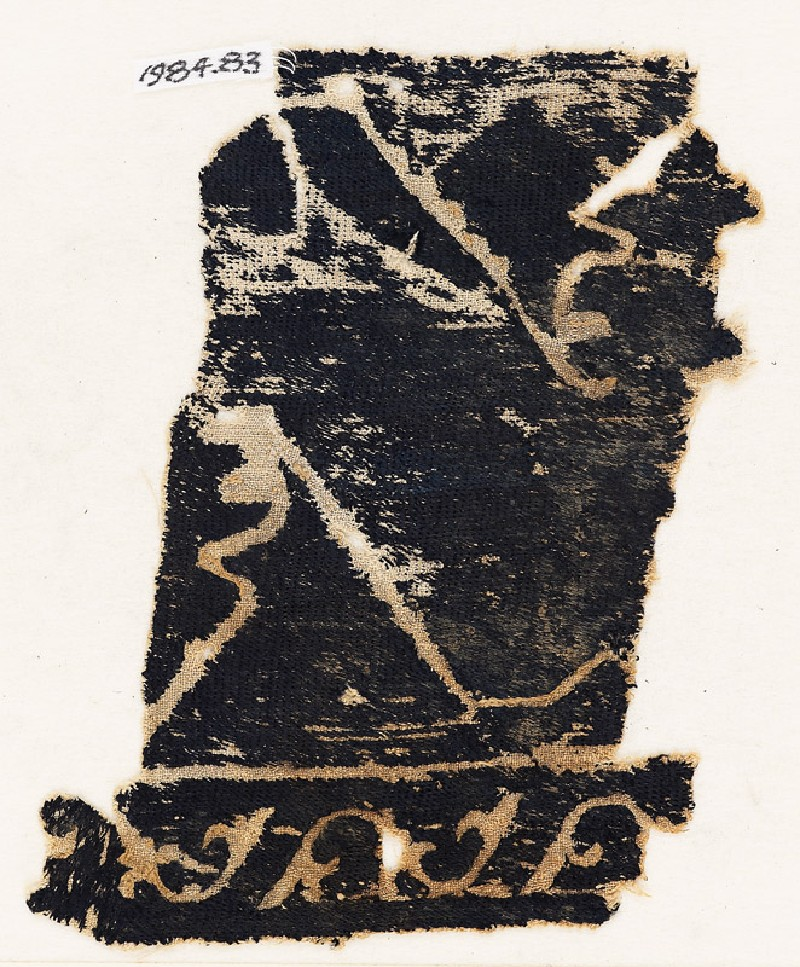 Textile fragment with tendrils, leaves, and possibly chevrons (front           )