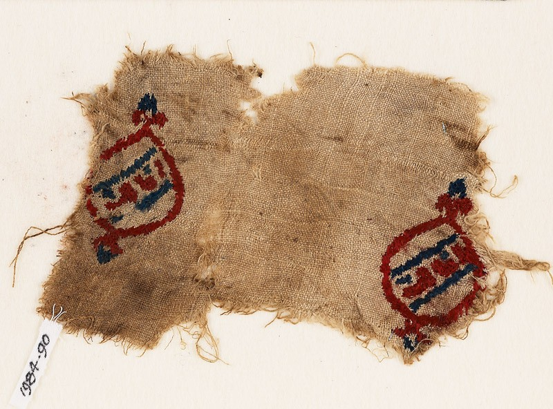 Textile fragment with blazons and inscription (EA1984.90, front           )