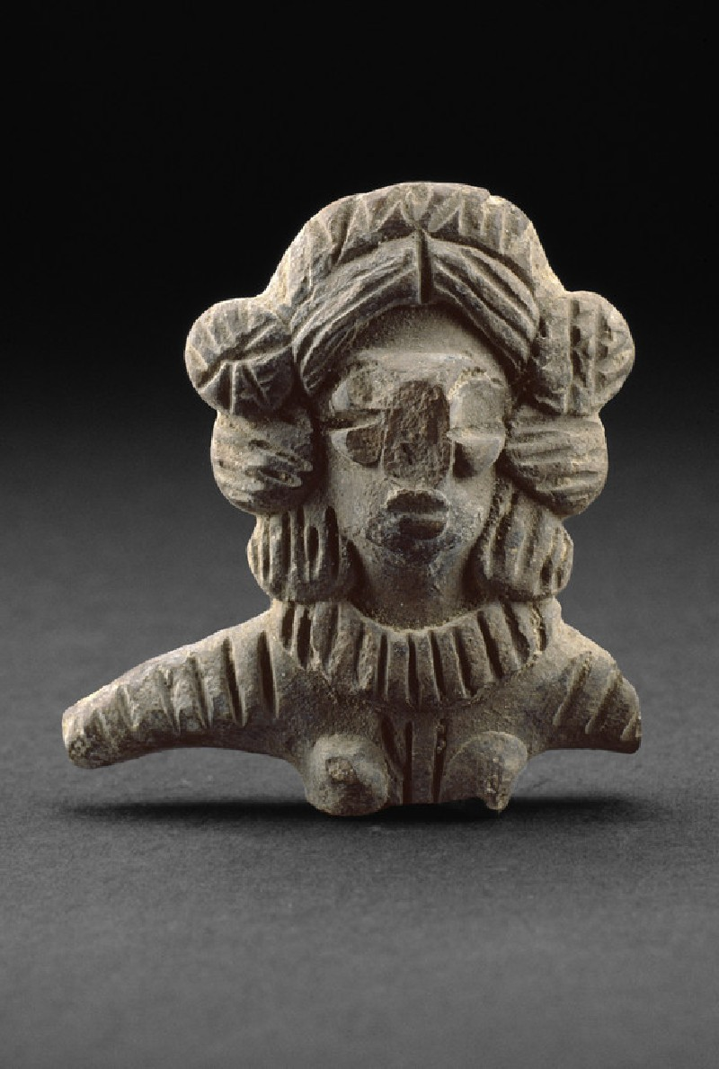 Bust of a female figure with ornamentation