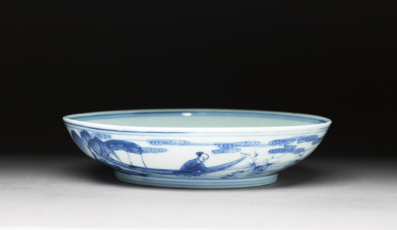 Blue-and-white dish with figures in a landscape