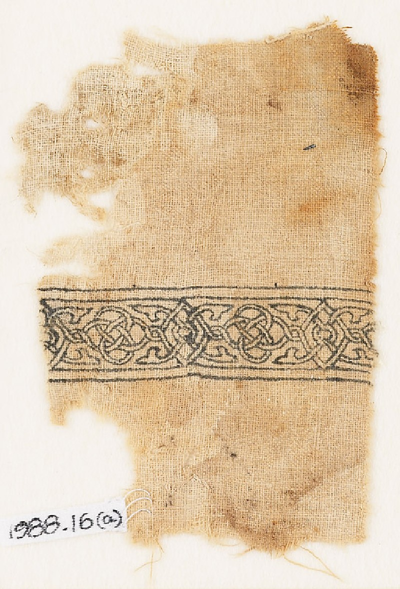 Textile fragment with band of interlacing and four-leaved tendrils