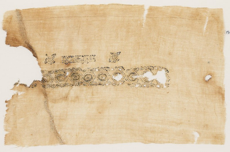 Textile fragment with band of hexagons and inscription