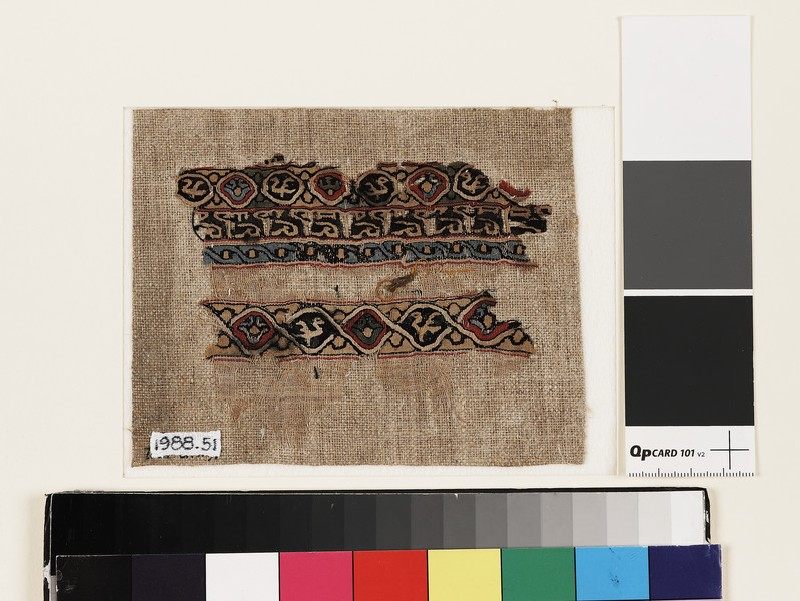 Textile fragment with interlacing roundels, birds, and pseudo-inscription (front           )