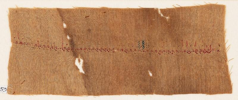 Textile fragment with pseudo-inscription (front           )