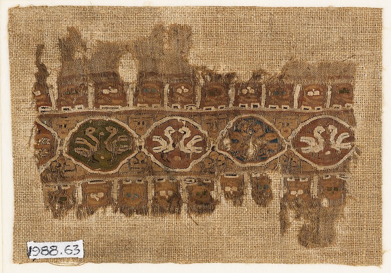 Textile fragment with linked medallions and birds (front           )